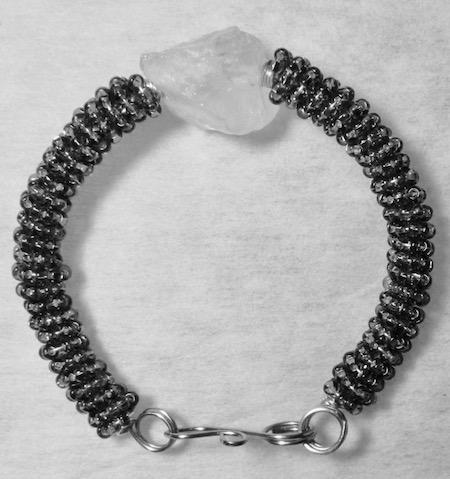 mo_bk_sl_wt_stn_bracelet_242016